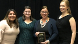 The Be Well initiative was named Program of the Year by NASPA. Pictured at the awards ceremony (from left): Christine Albain, 玛塞拉·鲁内尔·霍尔, Caroline Horne and Ivonne Ramirez, all from the 学生生活的分工.